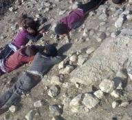 Children lie where they were killed by militants.