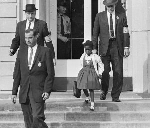 Ruby Bridges on her first day in school, accompanied by US marshals (click to enlarge)