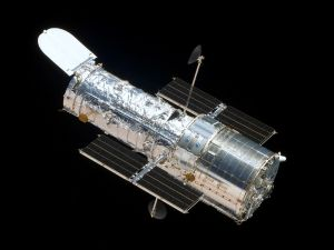 The Hubble Space Telescope in orbit, as seen from the Space Shuttle Atlantis.