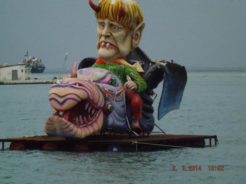 Even the waters of Patra harbor share in the parade of floats!